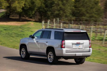 The 2015 GMC Yukon has three rows of seating, but it's shorter than the Yukon XL.