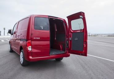 The curbside rear door is oversized. The cargo deck is low and flat.