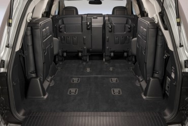 The rear seats on the Lexus LX570 fold up and out of the  way for ample cargo room.