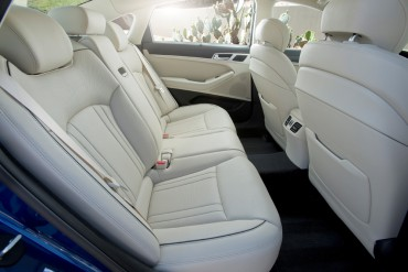 Wide opening doors make it  easy to slide into the luxurious rear seats.