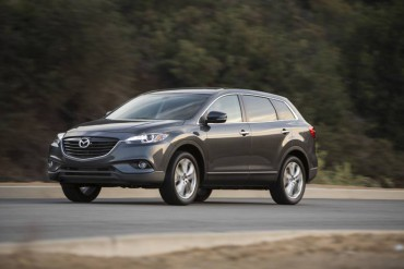 The 2015 Mazda CX-9 is a handsome seven-pasenger SUV that provides a great highway ride.