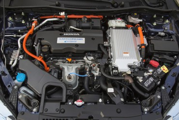 2015 Honda Accord Hybrid Touring engine compartment is jam-packed with a four-cylinder gas engine plus the hybrid electric motor.