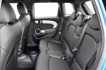 The rear seat is easily accessible and has room for adults if the front seats are up a ways.