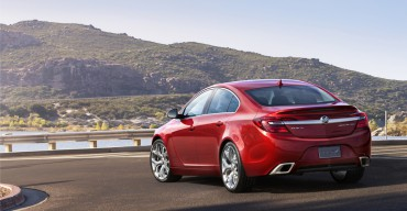 2015 Buick Regal GS ¾ rear view with Copper Red Metallic exterior color and 20-inch Alloy polished wheels