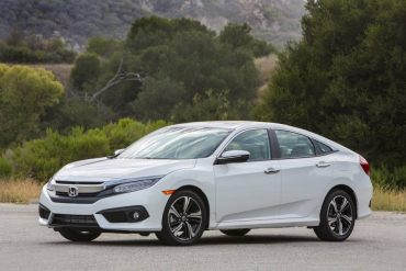 The 2016 Honda Civic has crisp styling with a wide familial grille and LED headlights.