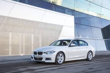 The 2016 BMW 330e looks like any other 3 Series BMW except for the small door in the left front fender.