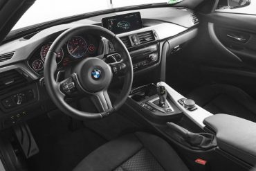 The interior is traditional BMW style, luxury, and high functionality.