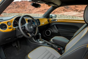 Front seat room in the VW Dune is outstanding. The dashboard is painted body color.