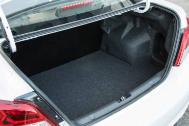 The trunk is spacious, but the lack of a folding rear seat limits cargo flexibility.