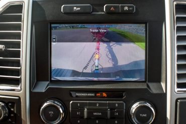 The trailer backup assist uses a camera to facilitate backing up a trailer.